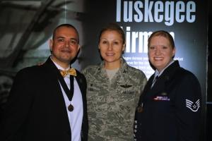 Paul de Souza, USAF Colonel April Vogel, and USAF SSgt Christine de Souza