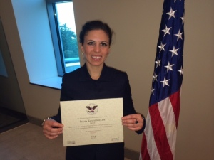 CSFI International Engagement Coordinator Dr. Lydia Kostopoulos receiving Presidential Award