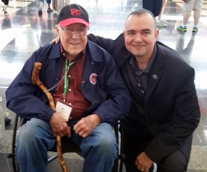 Paul de Souza with a World War II Veteran at the Honor Flight event.