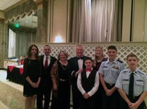 Guest of Honor James McLaughlin Lieutenant General, USAF Deputy Commander of USCYBERCOM, wife, and the de Souza family.