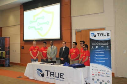 Mr. Steven Covey, True IA Managing Director, the inNOVAtion Hackathon crew, and True IA VP Mr. Nathaniel Wade at the True IA booth.
